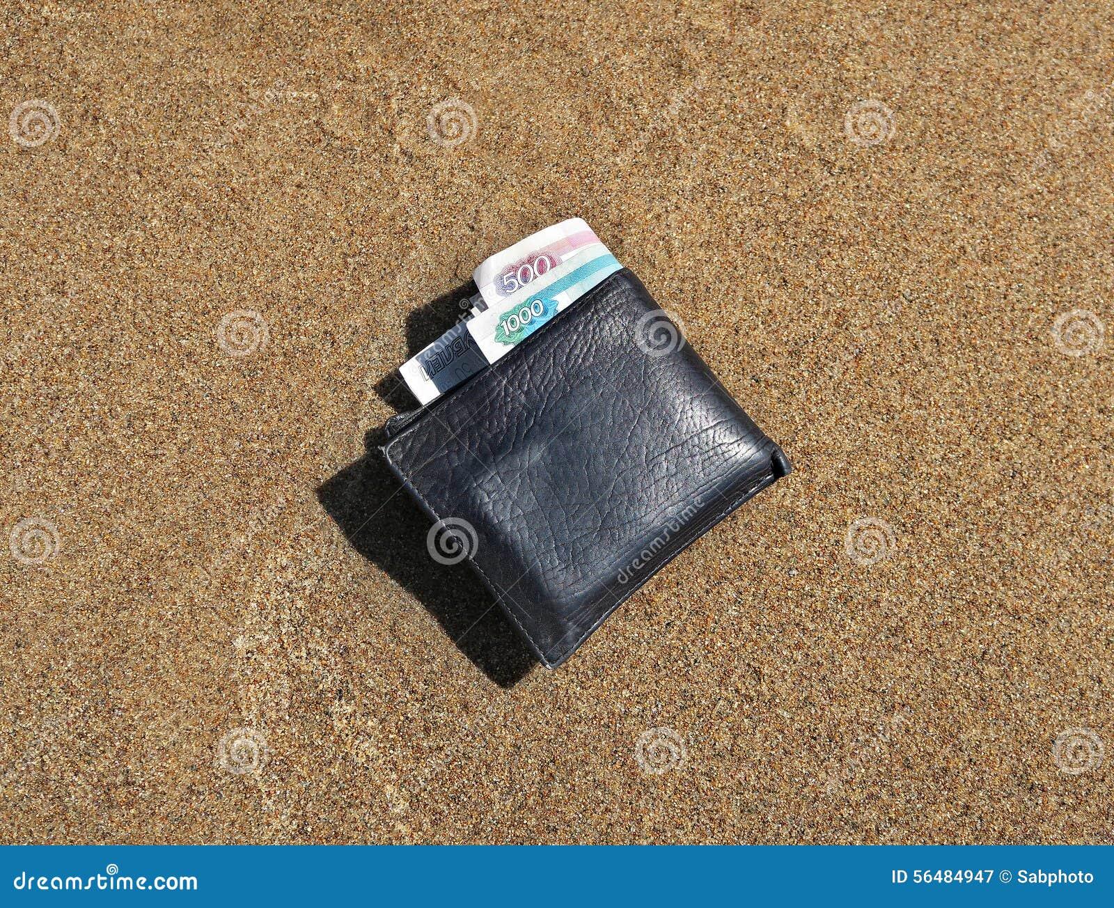 Portefeuille sur le sable