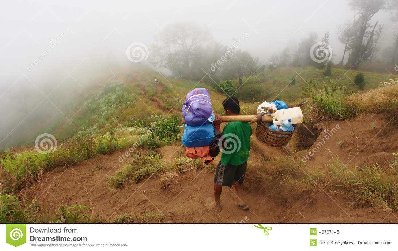 A porter going down from Rinjani mountain, Lombok, Indonesia
