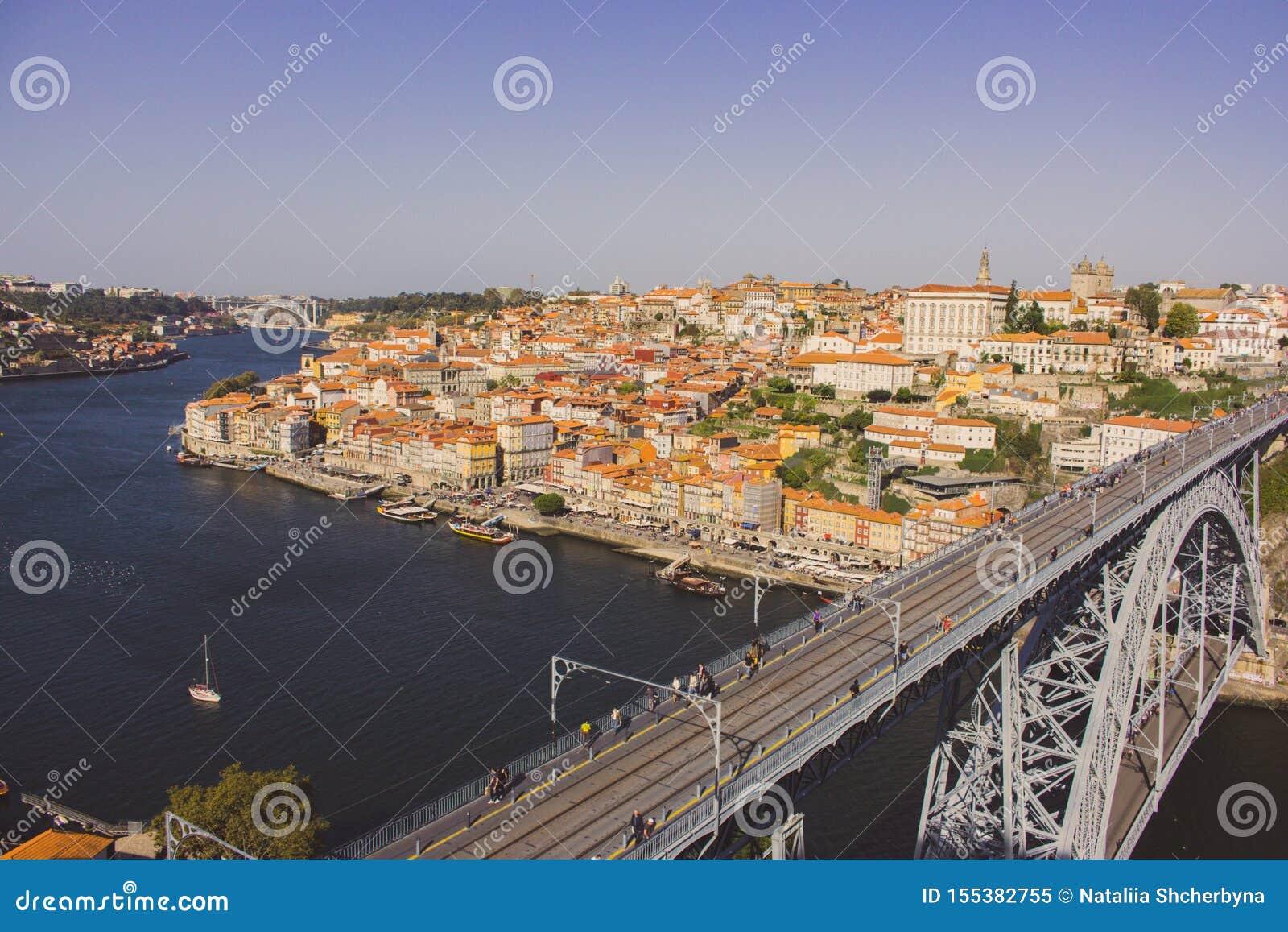 Famous Porto bridge Ponte Luis top view. Porto bridge over river Douro. Portuguese river Douro with metro bridge and tourists.
