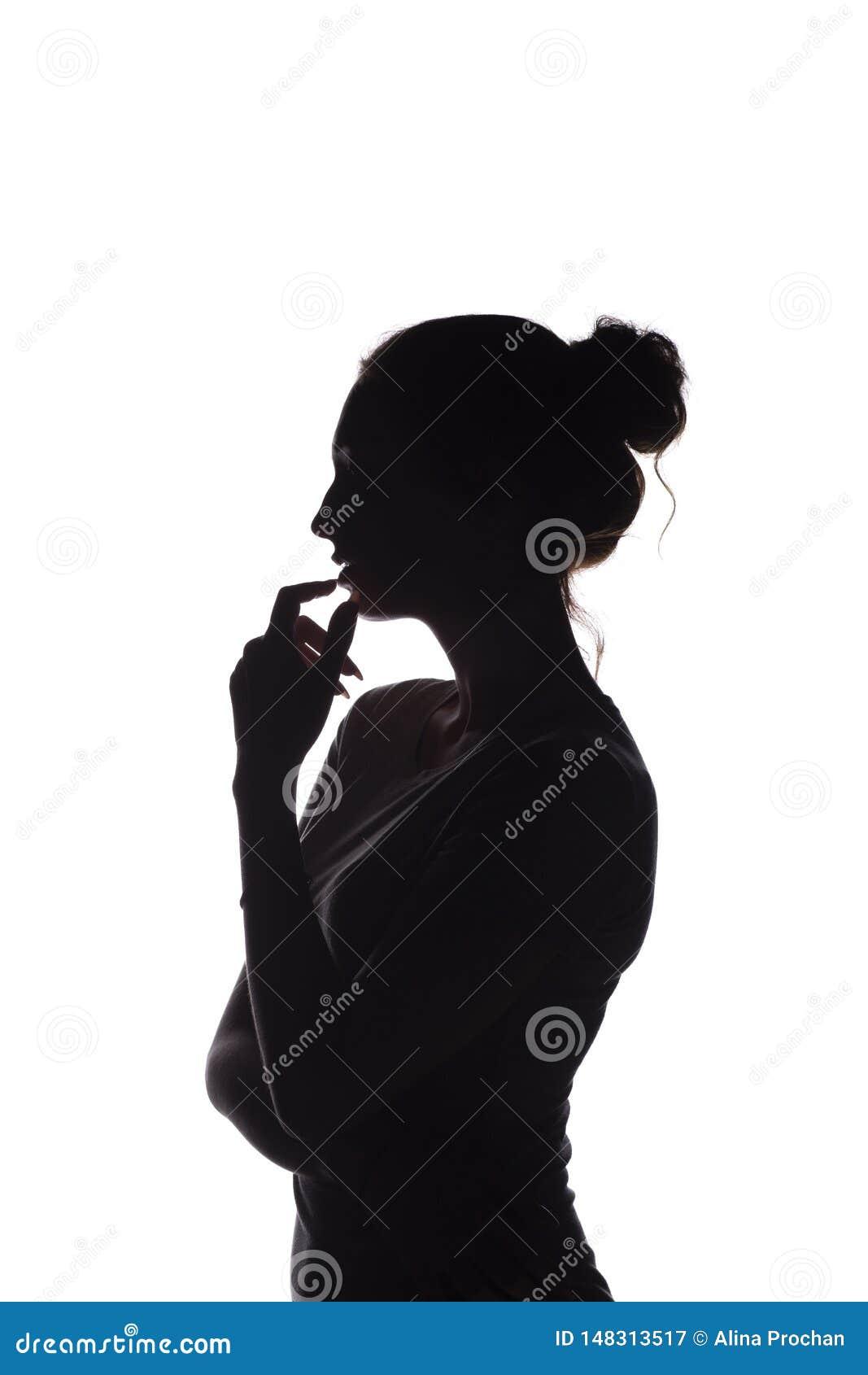 Porträtprofil des schönen Mädchens mit dem handverlesenen Haar, des Schattenbildes einer Frau auf einem weißen lokalisierten Hint