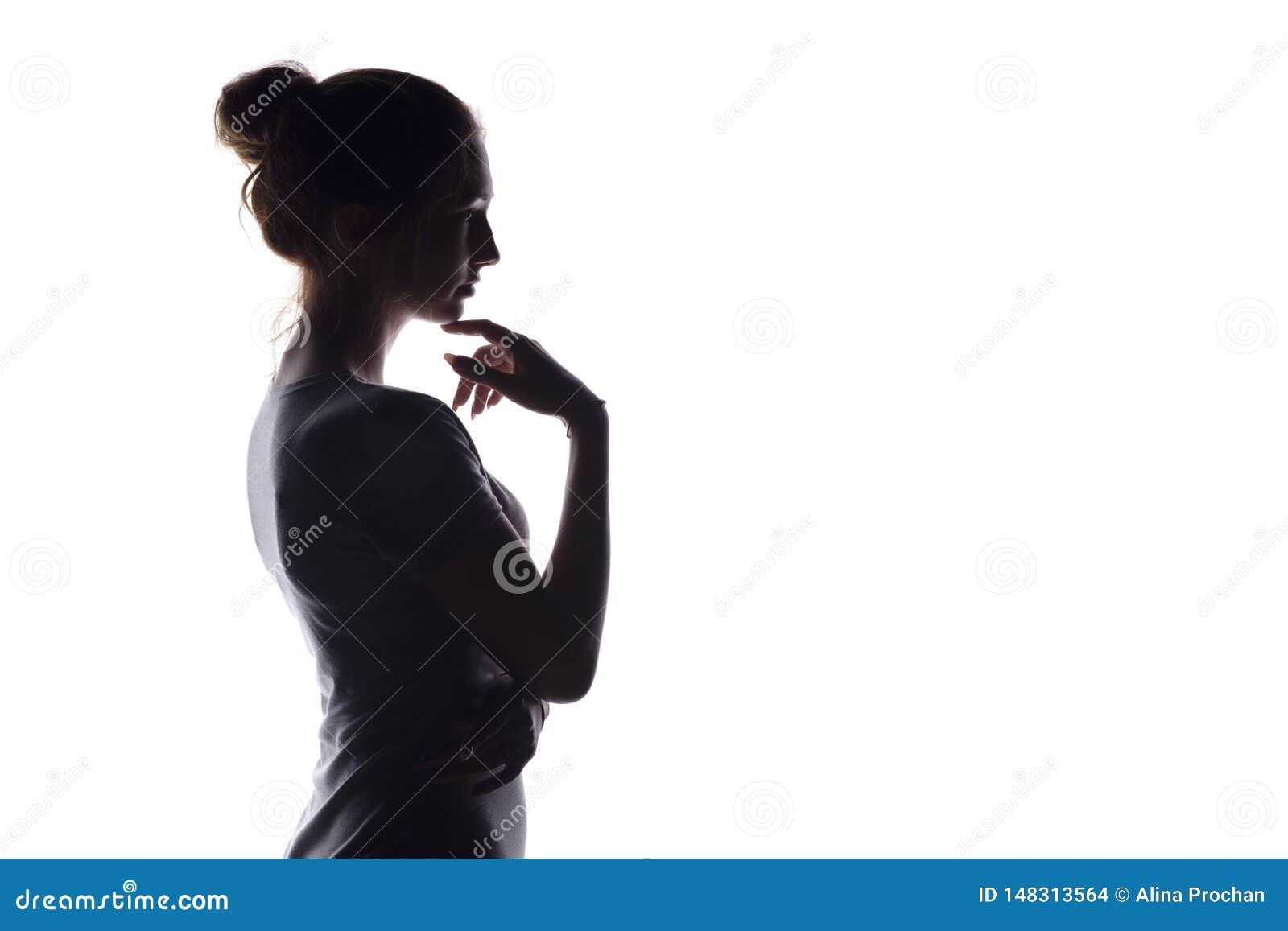 Portr?tprofil des sch?nen M?dchens mit dem handverlesenen Haar, des Schattenbildes einer Frau auf einem wei?en lokalisierten Hint