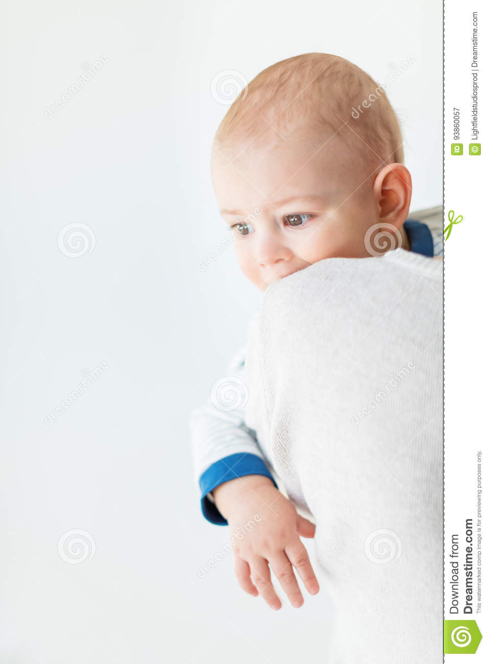 Portrait of adorable baby boy looking away isolated on white