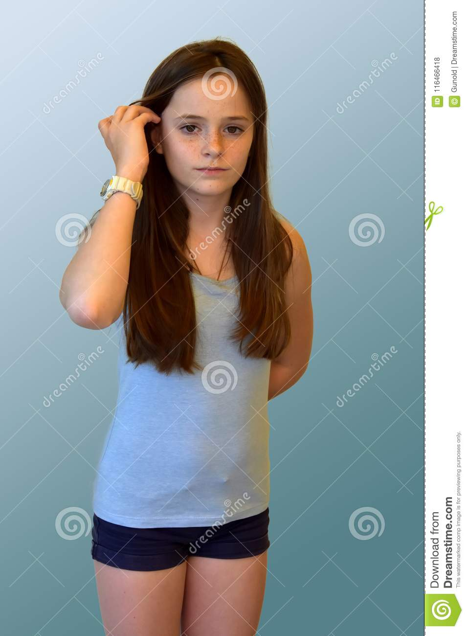 Teenage girl with long brown hair and freckles