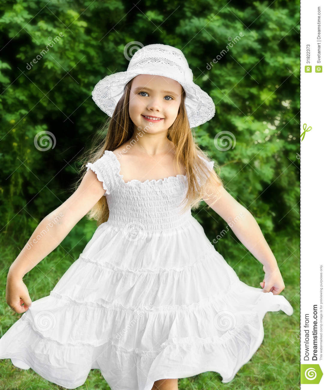 Portrait Of Adorable Smiling Little Girl In White Dress And Hat ...