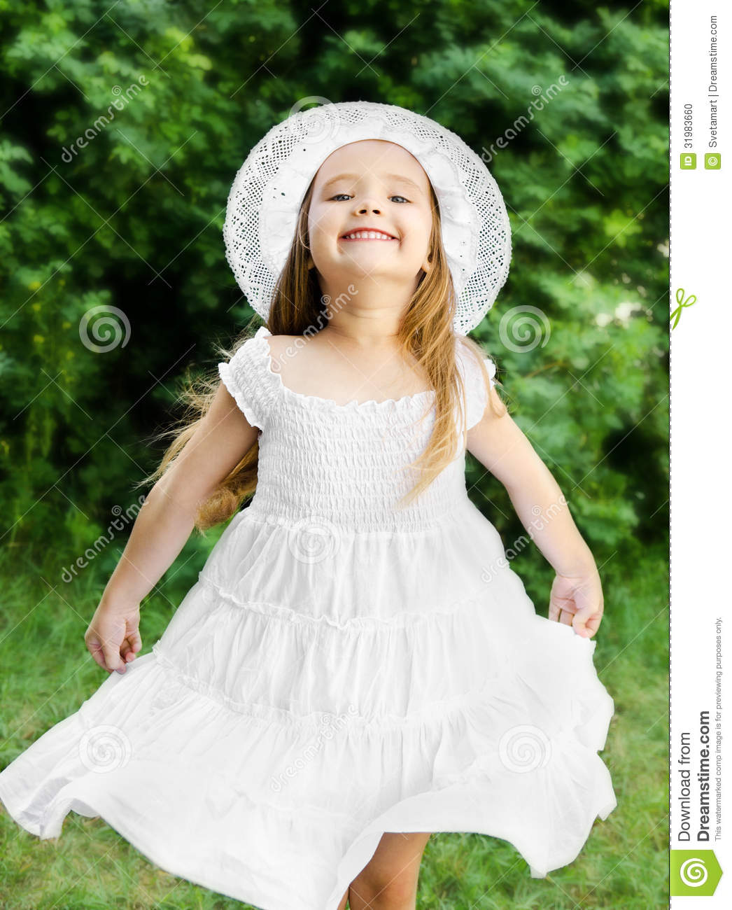 95173a2de Portrait Of Adorable Smiling Little Girl In White Dress And Hat ...