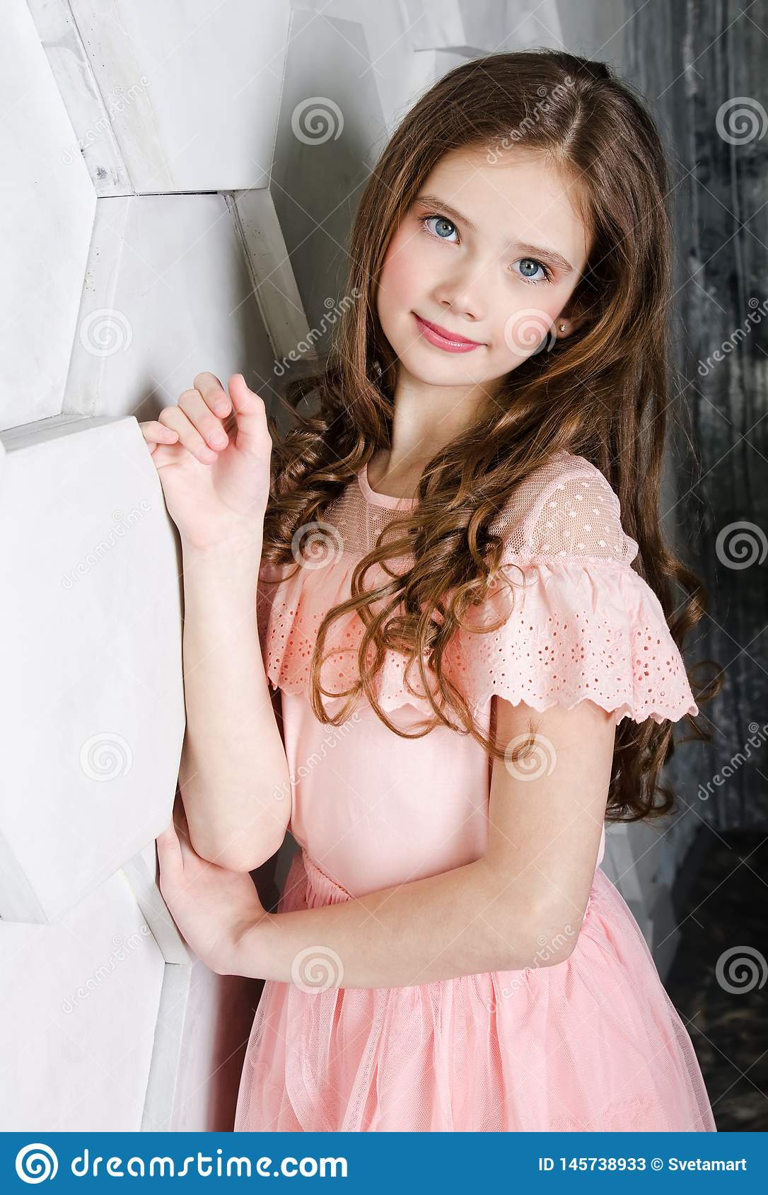 Portrait of adorable smiling standing little girl child