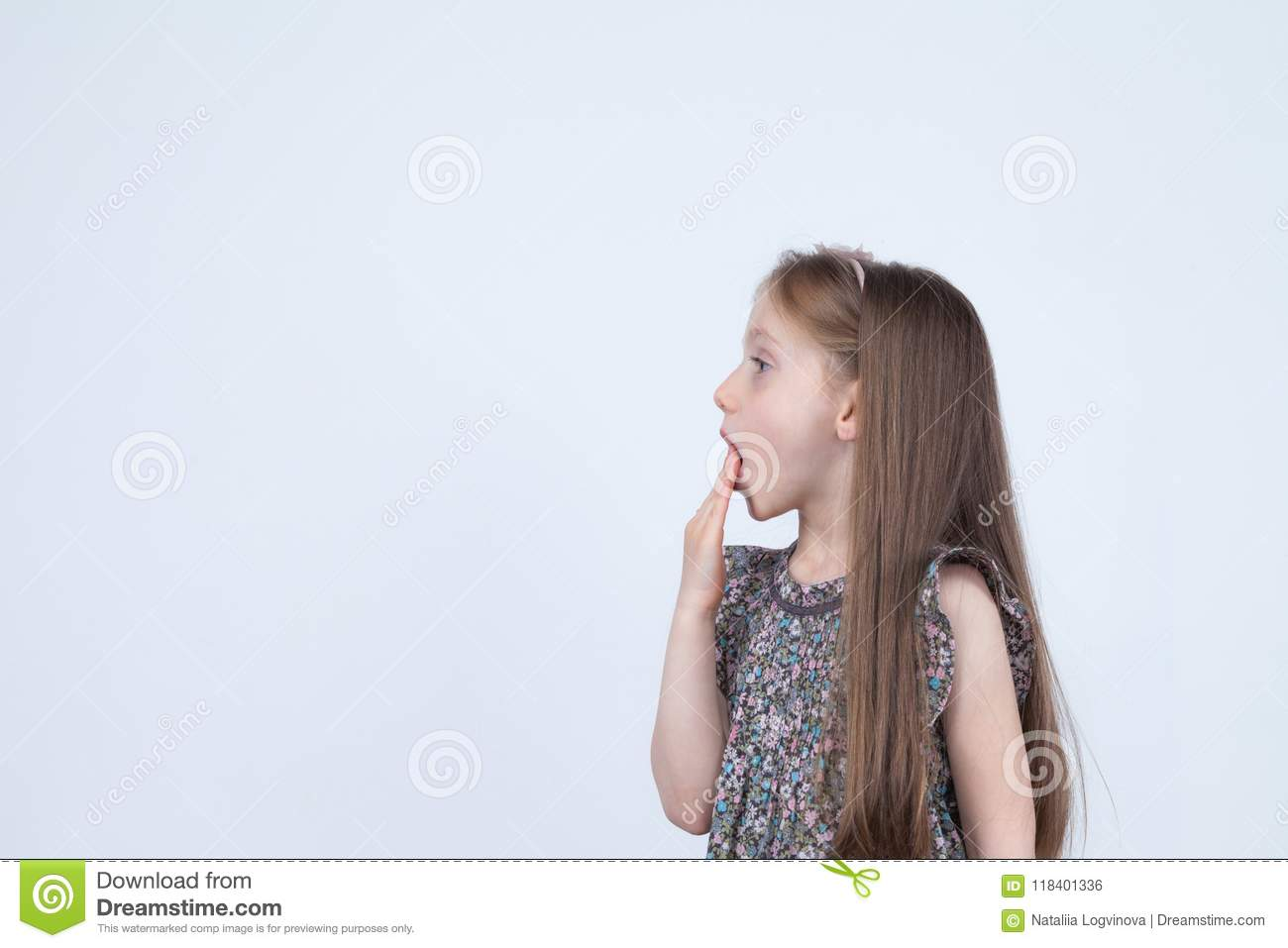 Portrait of adorable surprised astonished little girl isolated on a white. Girl child holding hands at the mouth surprised. Wow em