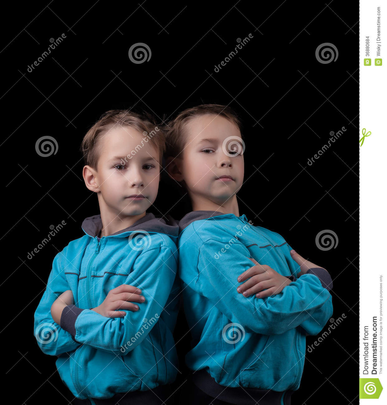 Portrait of adorable twin boys on black