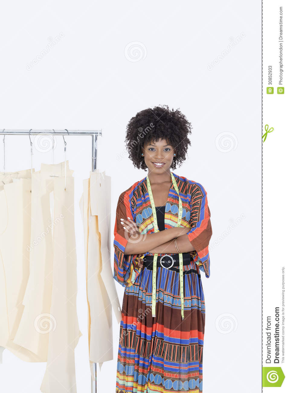 of an African American female designer with sewing patterns on clothes