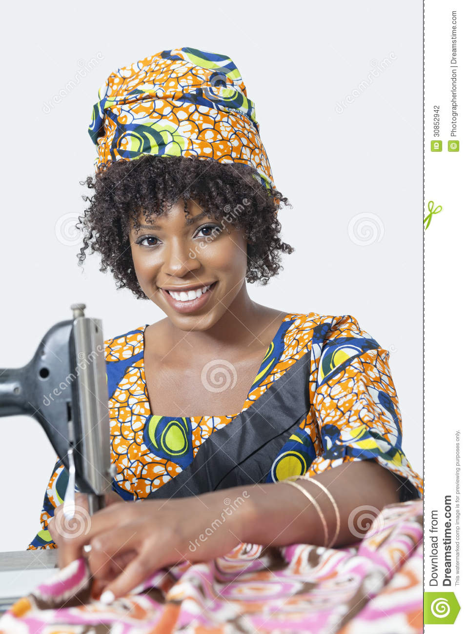 Portrait Of An African American Woman Using Sewing Machine