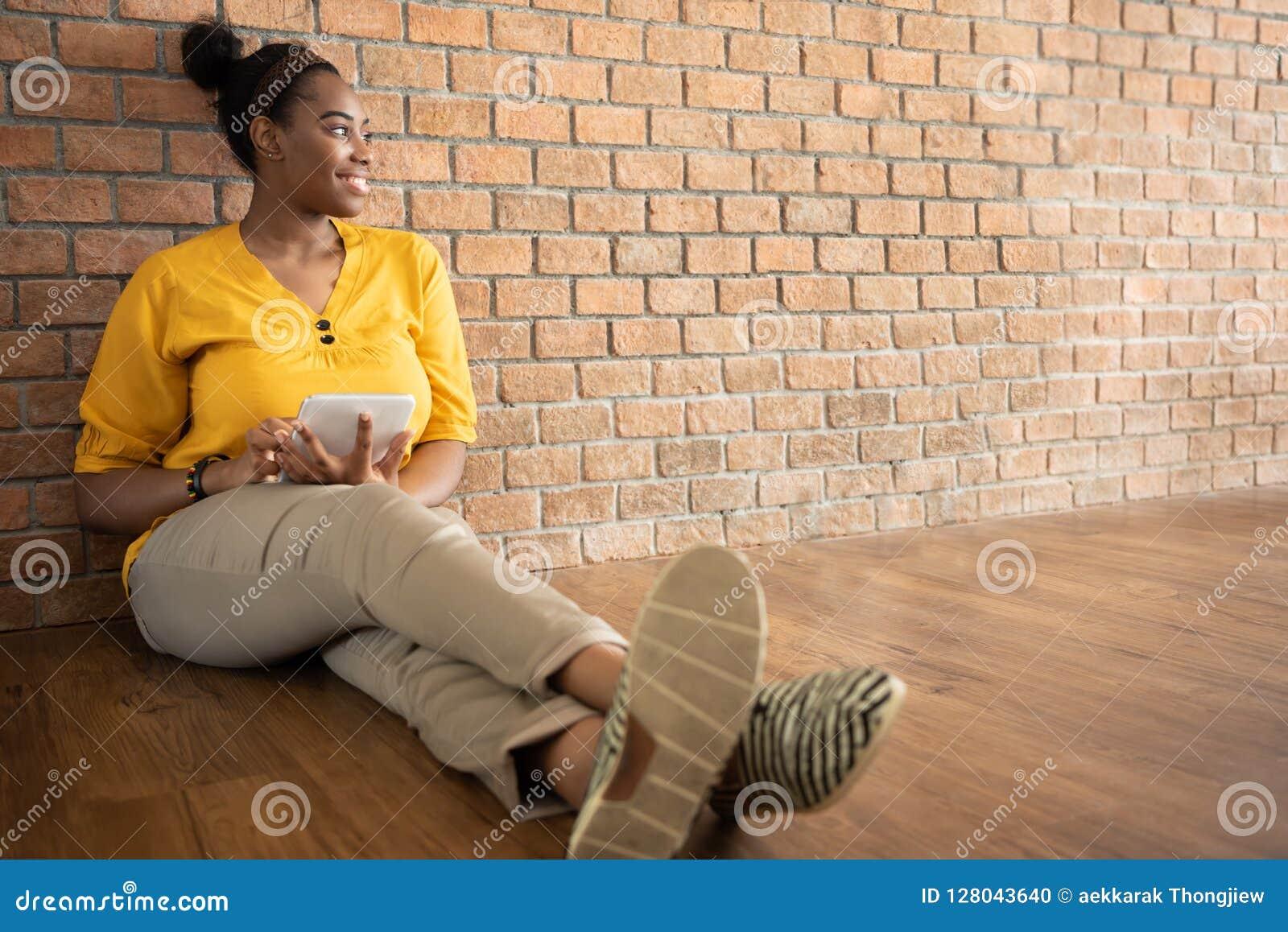 Portrait of African Female Creative Designer in Yellow shirt usi