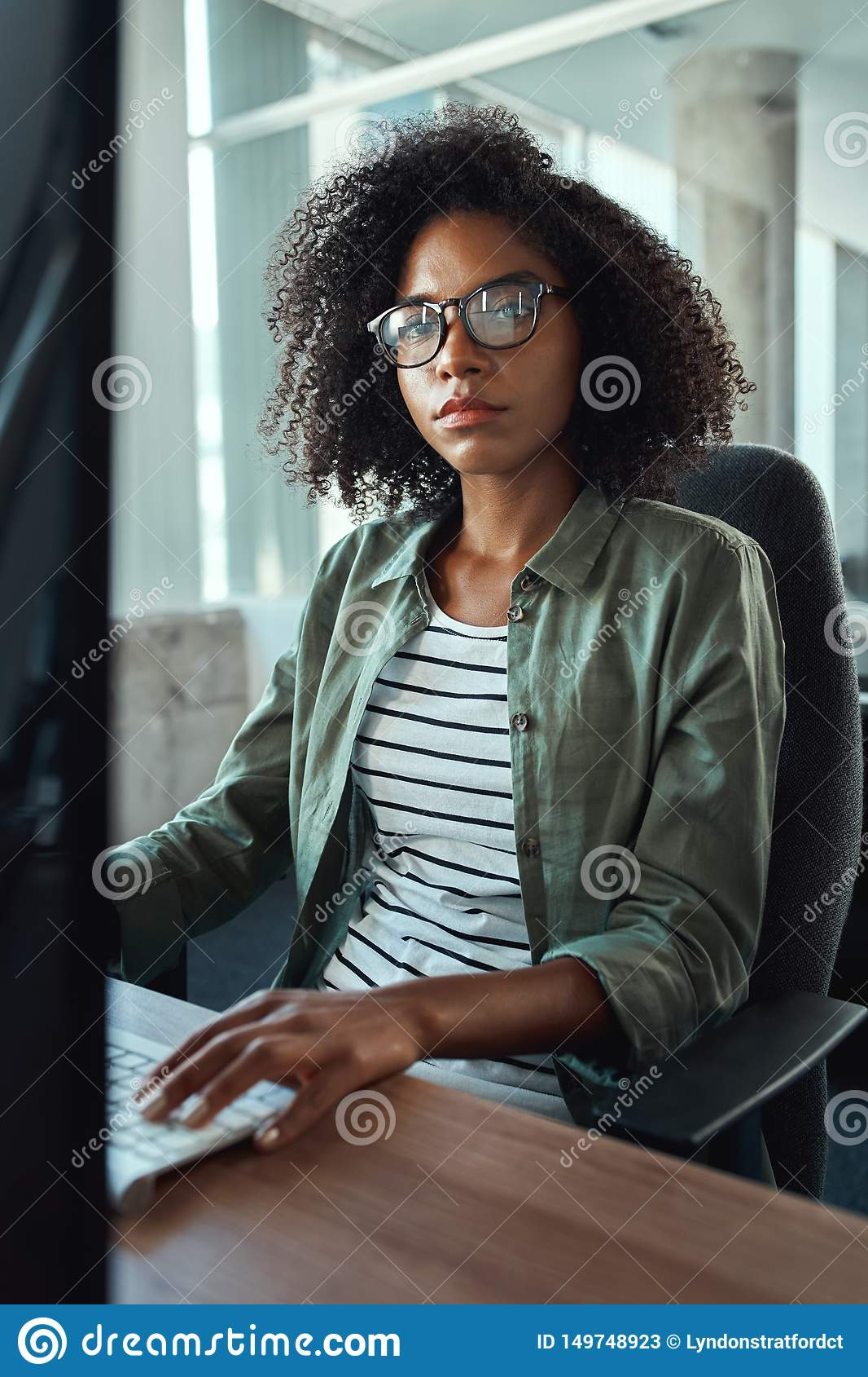 An african young businesswoman looking at camera