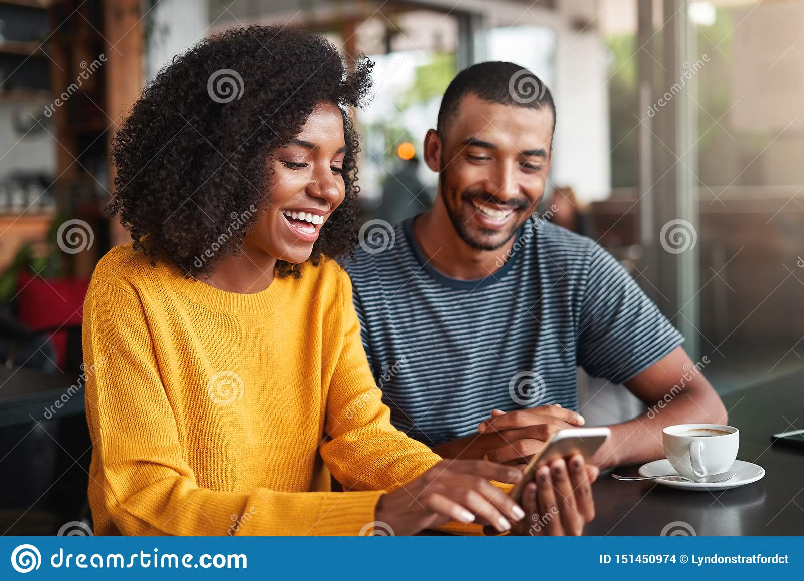 Young couple watching video on mobile phone