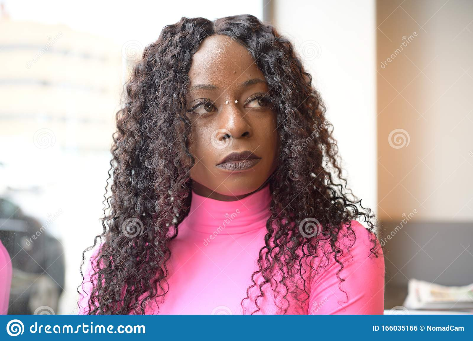 Portrait Of An Afro Style Black Girl With Long Black Curly Hair Looking To The Right In A Coffee Shop Stock Photo Image Of Long Camera 166035166