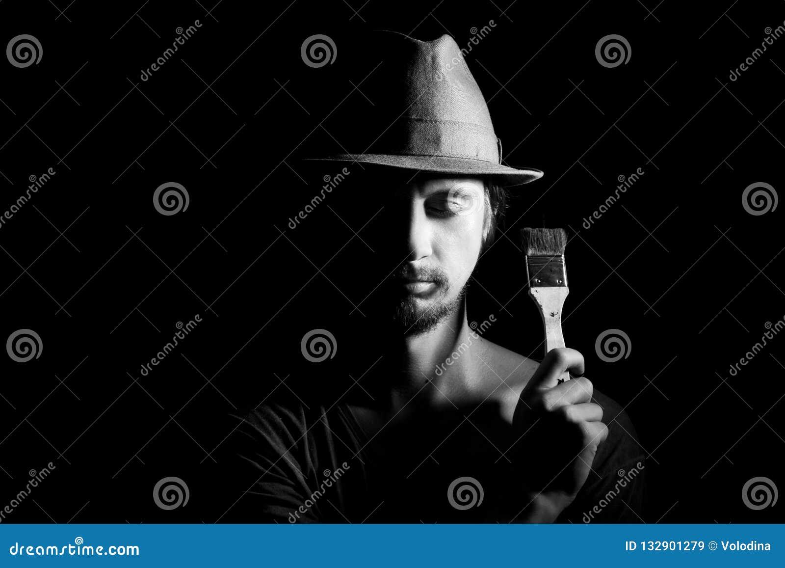 Portrait of artist-man with hat