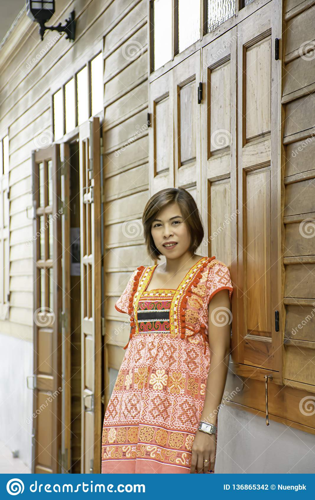 Portrait of Asean woman wearing a native of northern Thailand background wooden wall