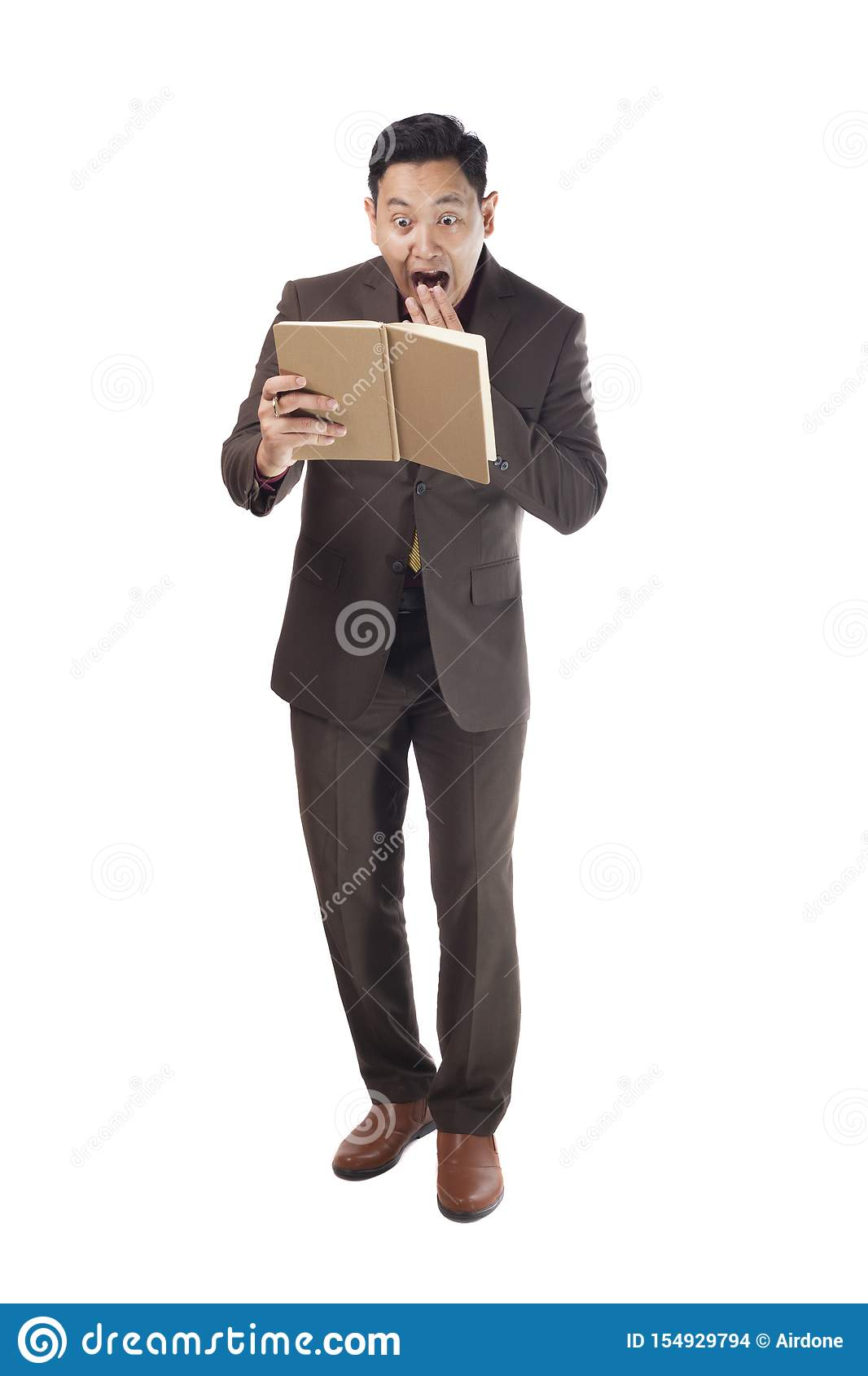 Asian Man Shocked Surprised When Reading a Book