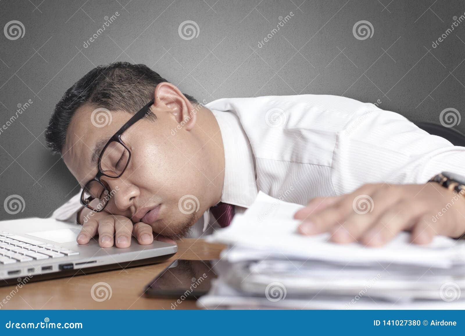 Tired Sleepy Asian Businessman Having Overworked