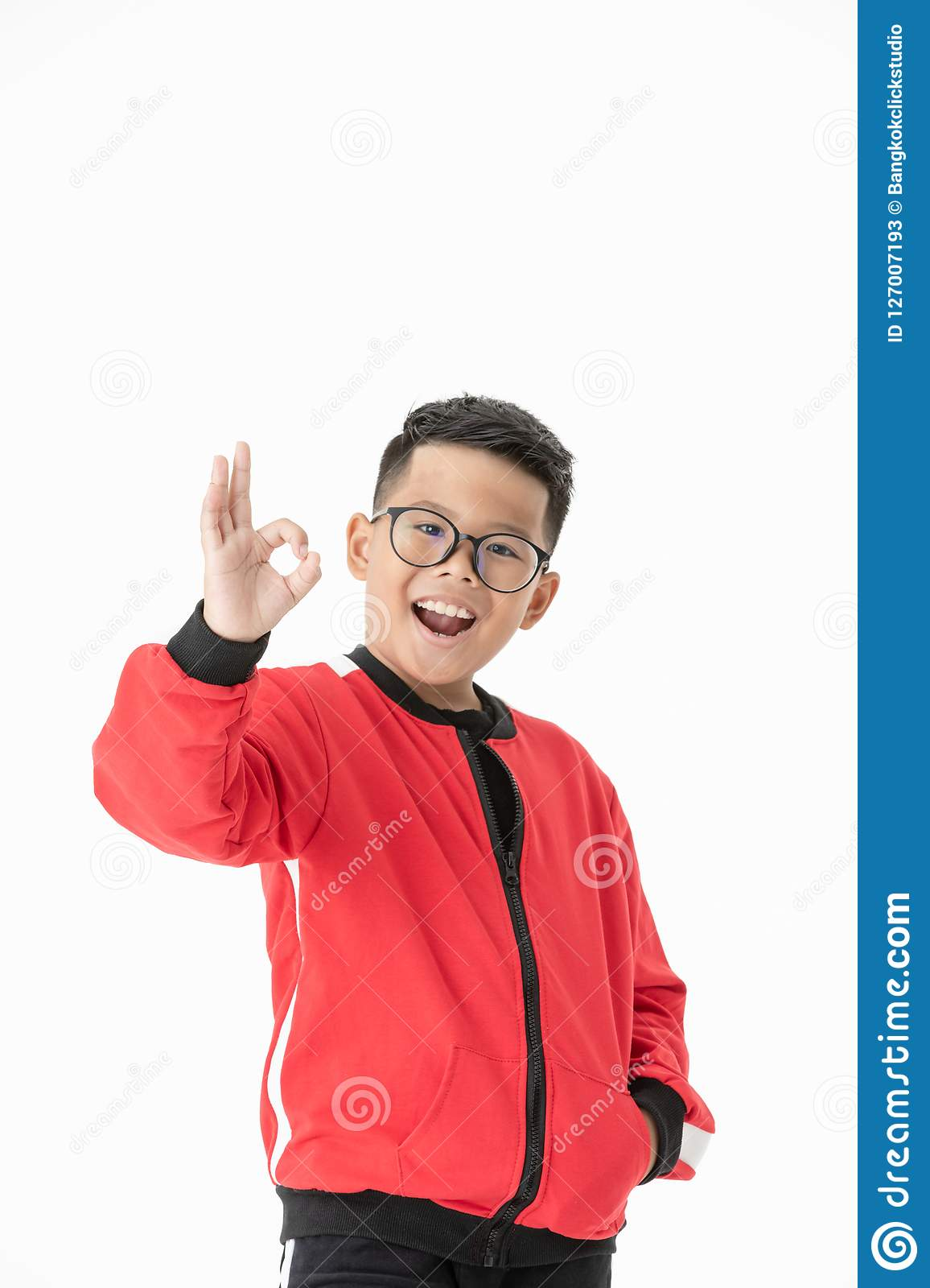 Portrait asian cute boy showing okay gesture isolated on white b