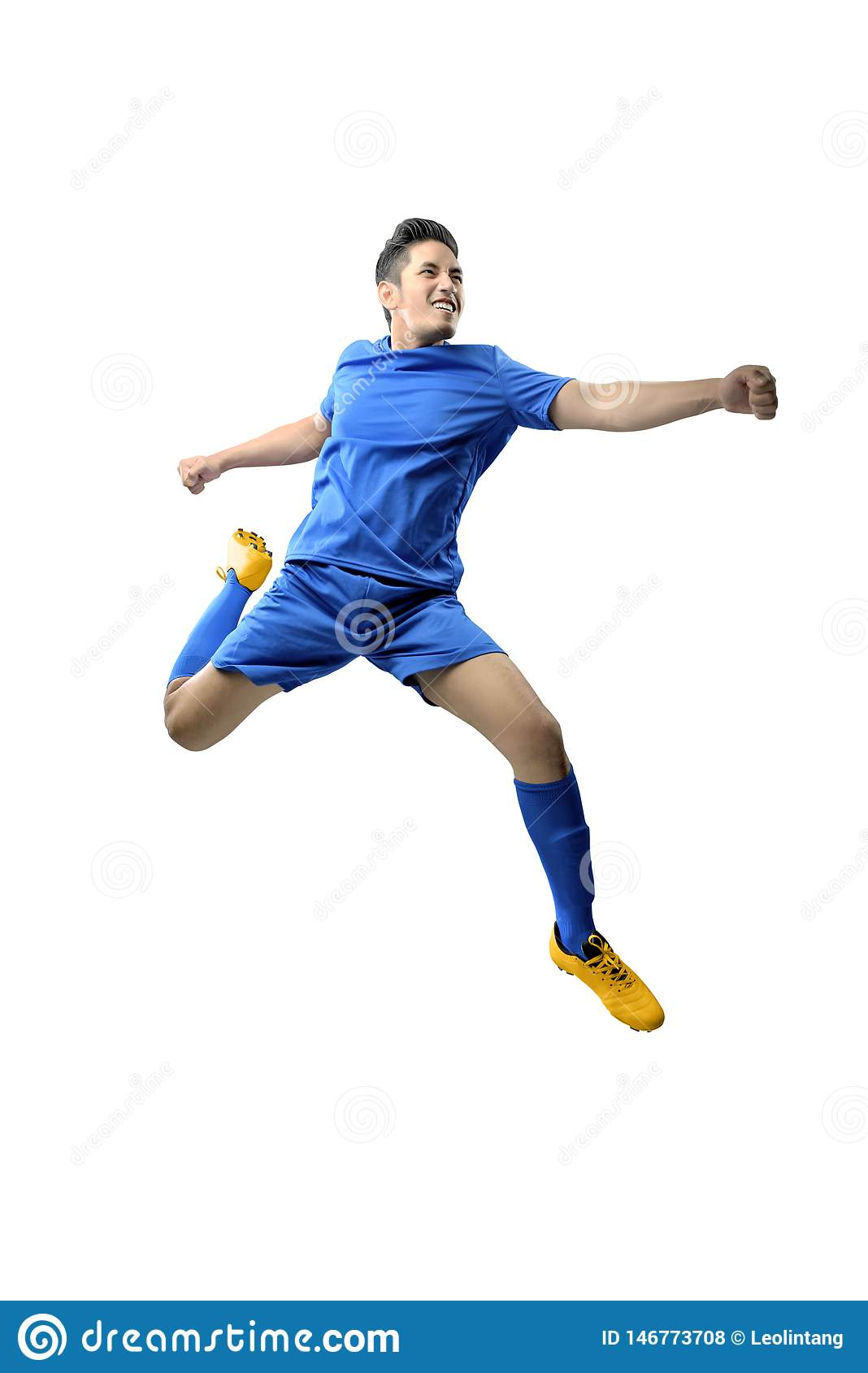 Portrait of asian football player man in blue jersey with kicking the ball position