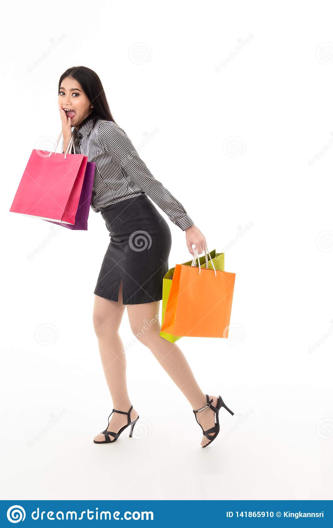 Woman holding shopping bags with gossip and surprising face expression