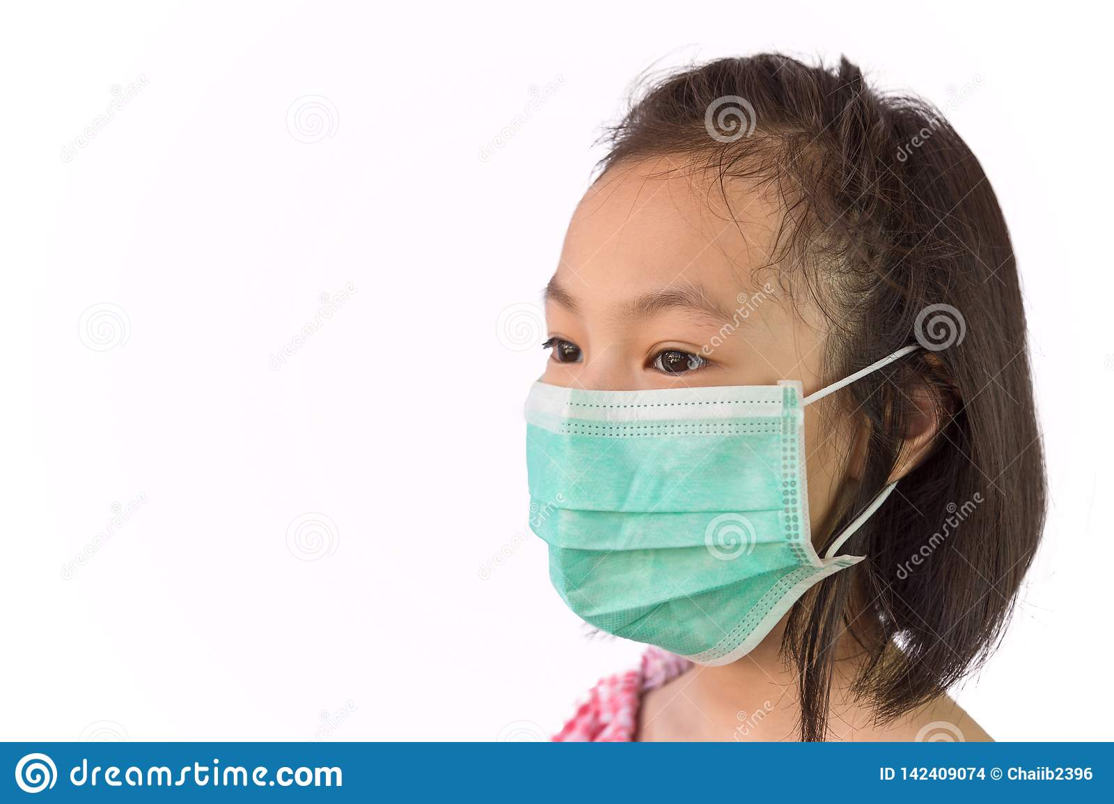 Portrait asian little girl in a medical mask isolated on white background,child wearing hygienic mask, concept of an epidemic,