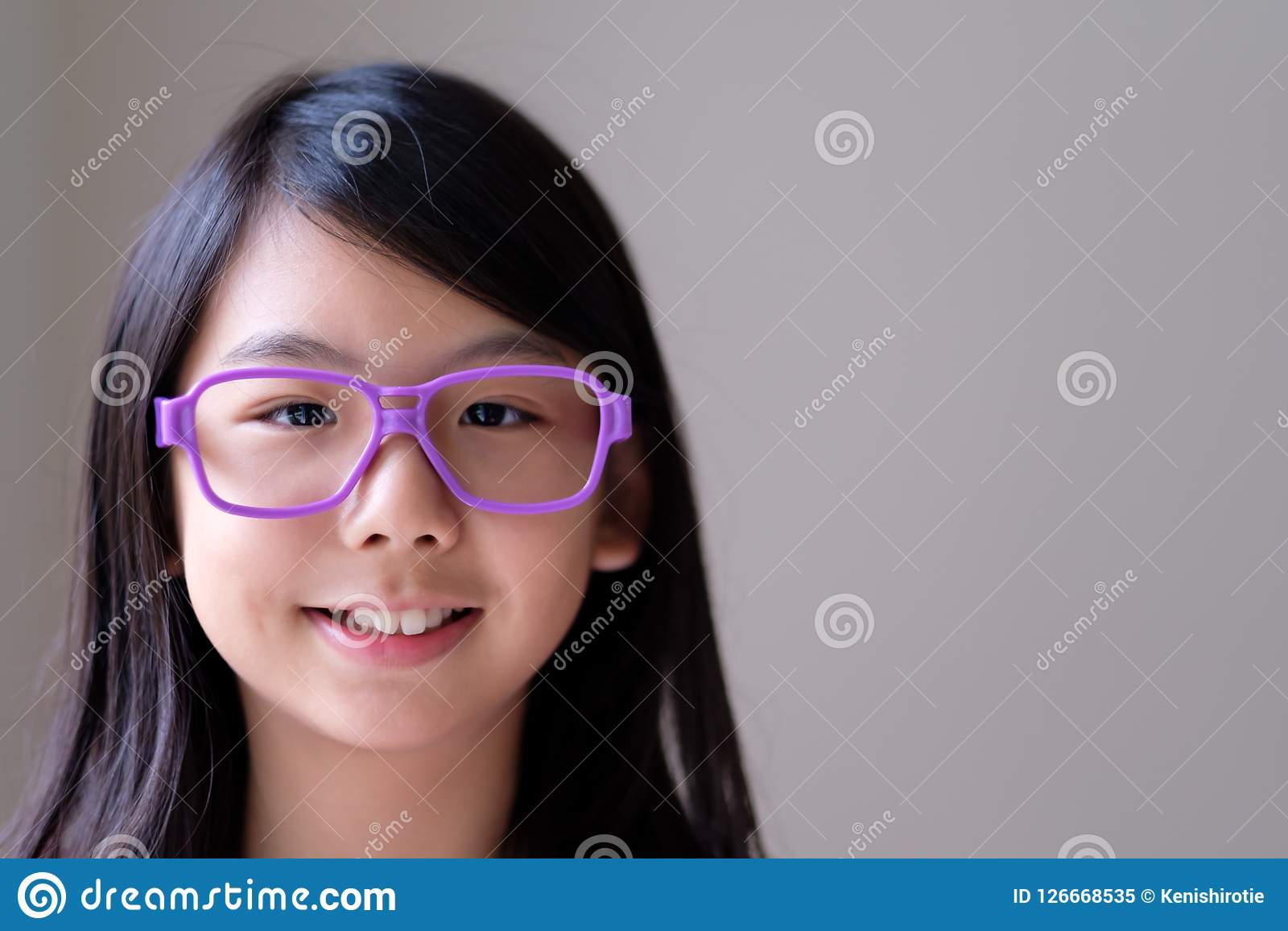 c05ac39d0bea Portrait Of Asian Teenager With Big Purple Glasses Stock Image ...