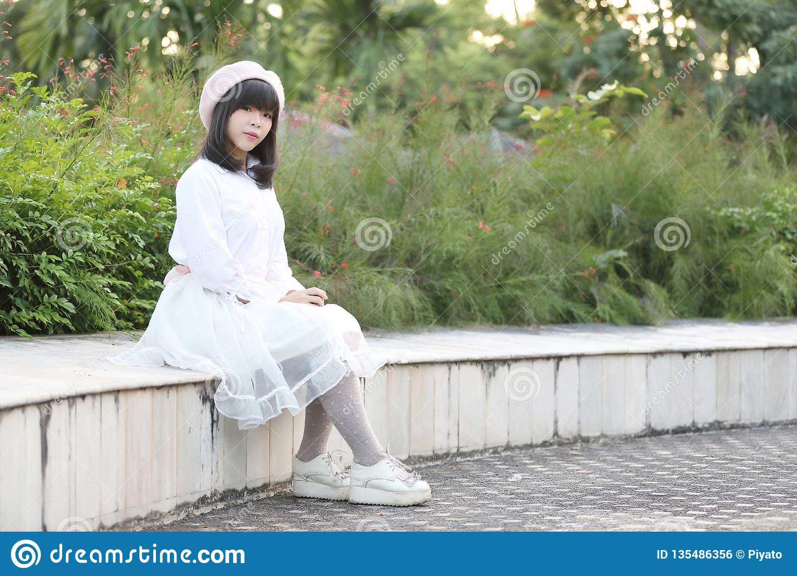 Portrait asian woman lolita dress on nature park