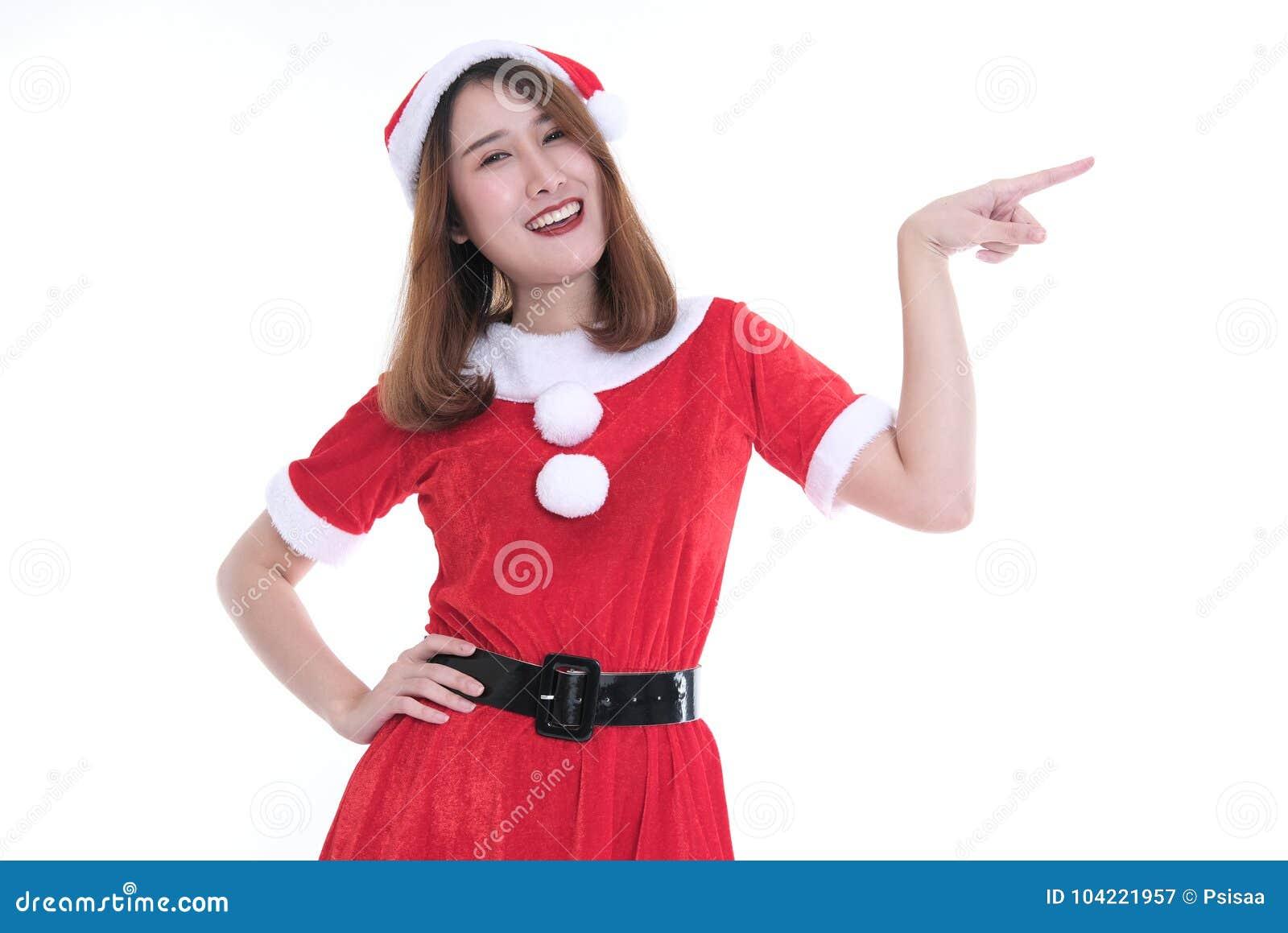 b462726ae4712 portrait of asian woman in santa claus dress on white background. christmas  holiday. merry xmas celebration. season  x27 s greetings