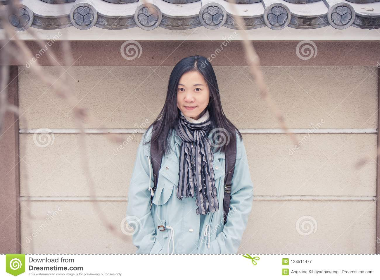 Portrait Asian woman traveler feeling enjoy and happiness with holiday trip at Japan.