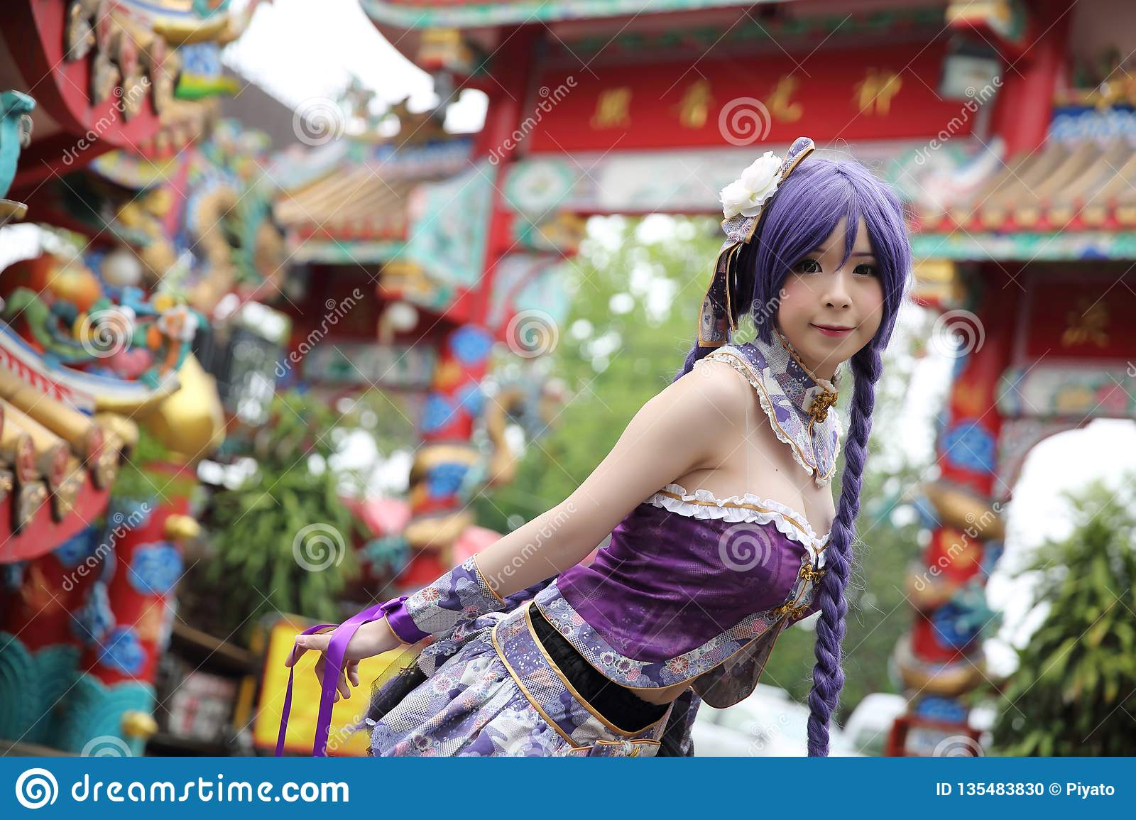 Portrait of asian young woman with purple Chinese dress cosplay with temple