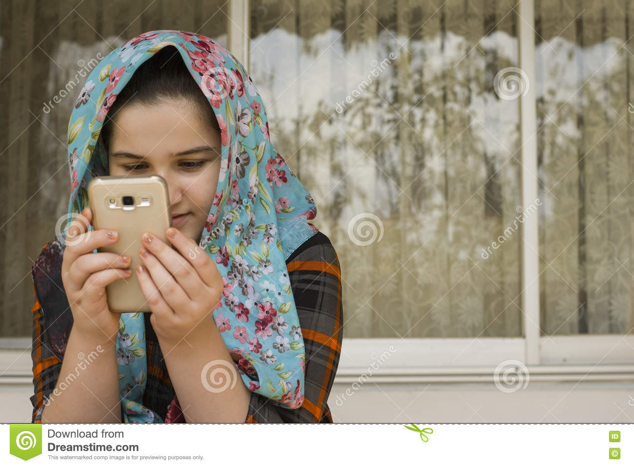 Portrait of attractive cute muslim girl working with smart phone rasht iran september