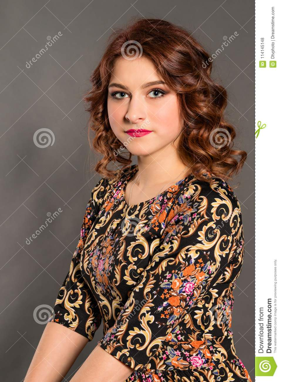 Portrait of an attractive girl on a neutral background