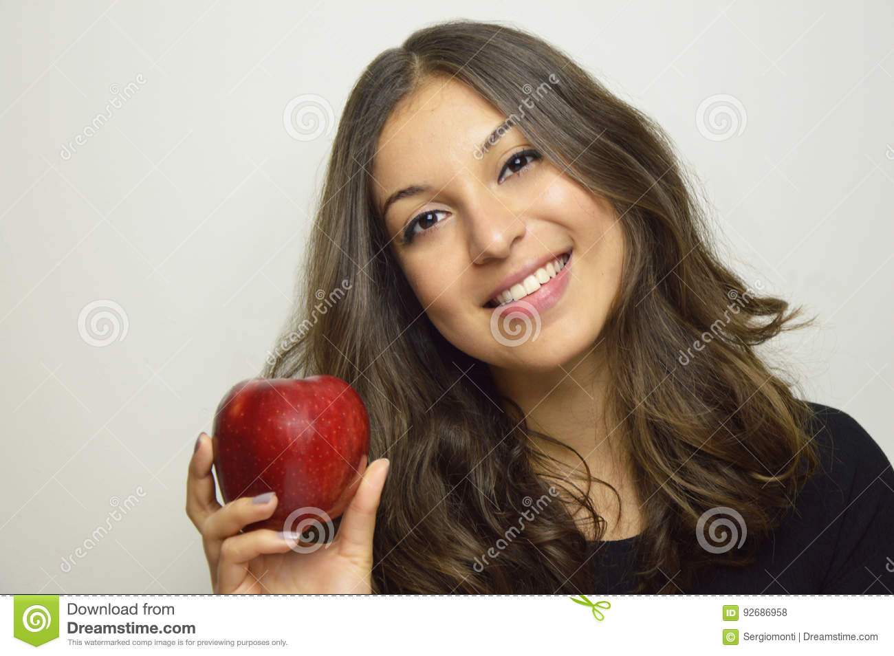 Portrait of attractive girl smiling with red apple in her hand healthy fruit