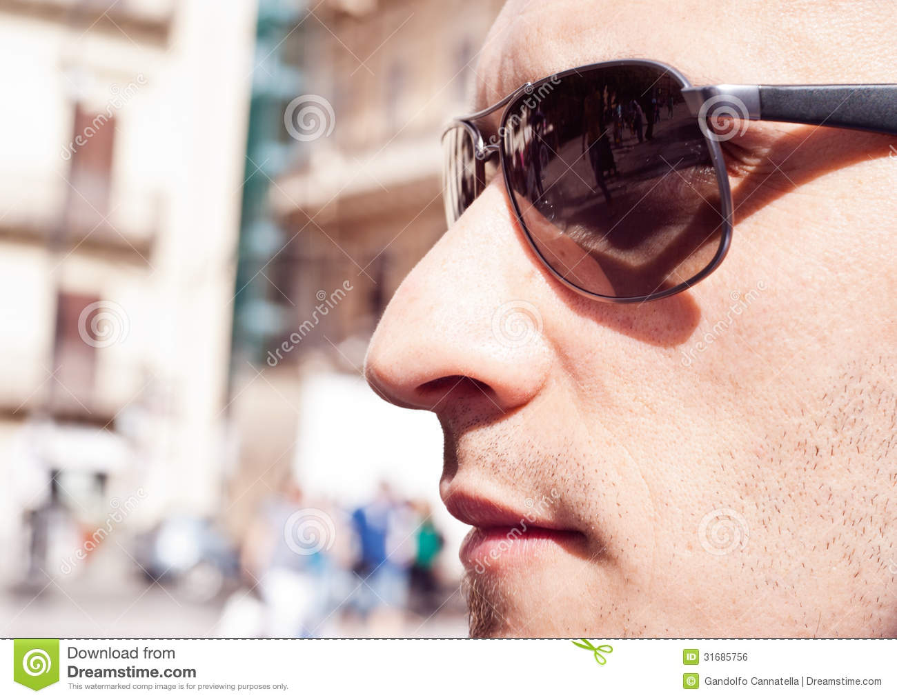 Portrait of a attractive gorgeous guy wearing sunglasses