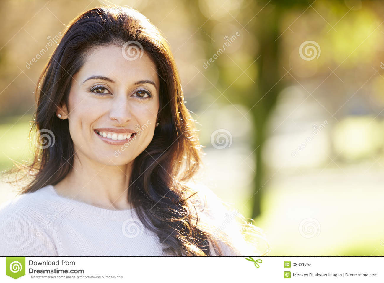 Portrait Of Attractive Hispanic Woman In Countryside