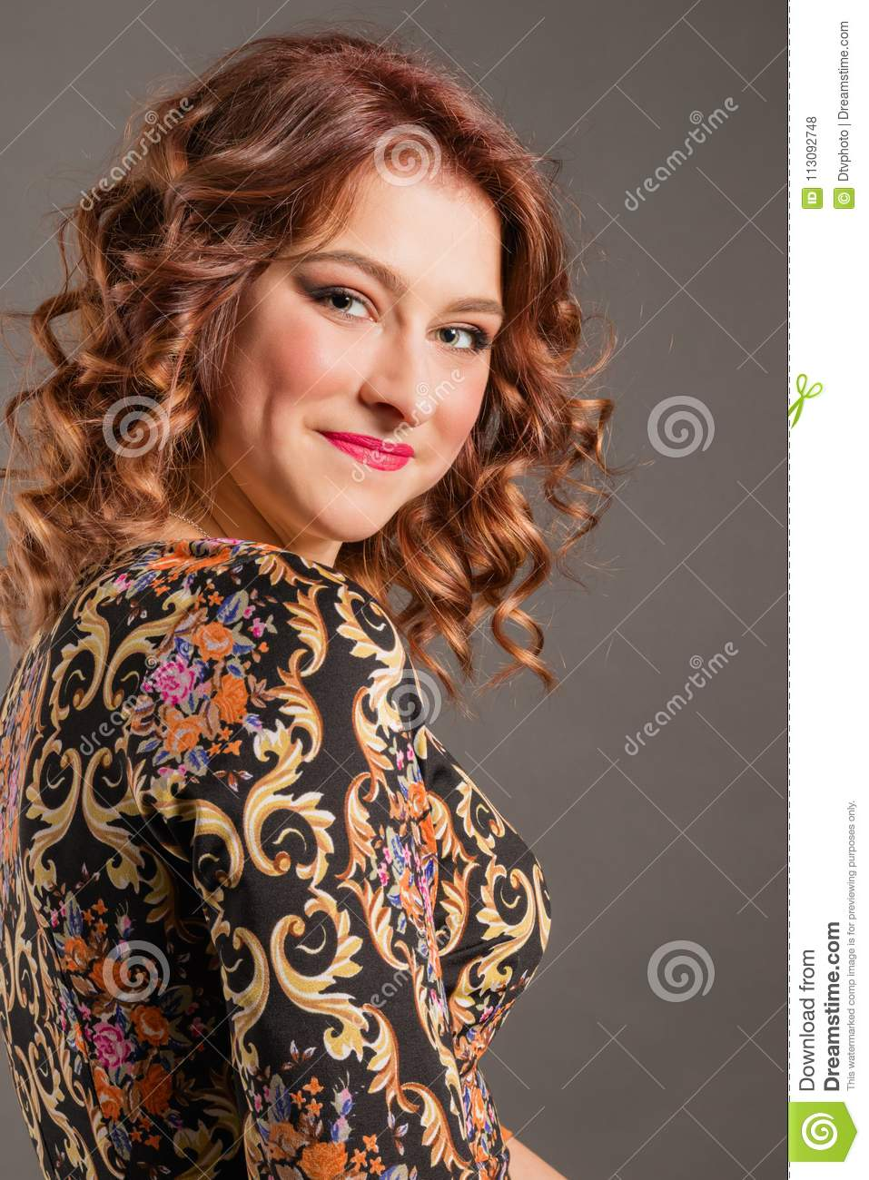 Portrait of attractive smiling girl on a neutral background
