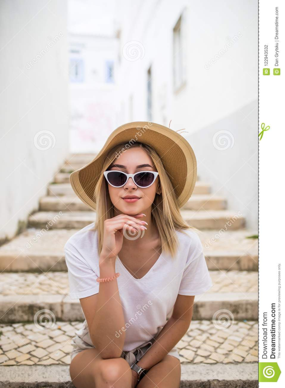 Portrait Of An Attractive Happy Woman Sitting On Stairs At