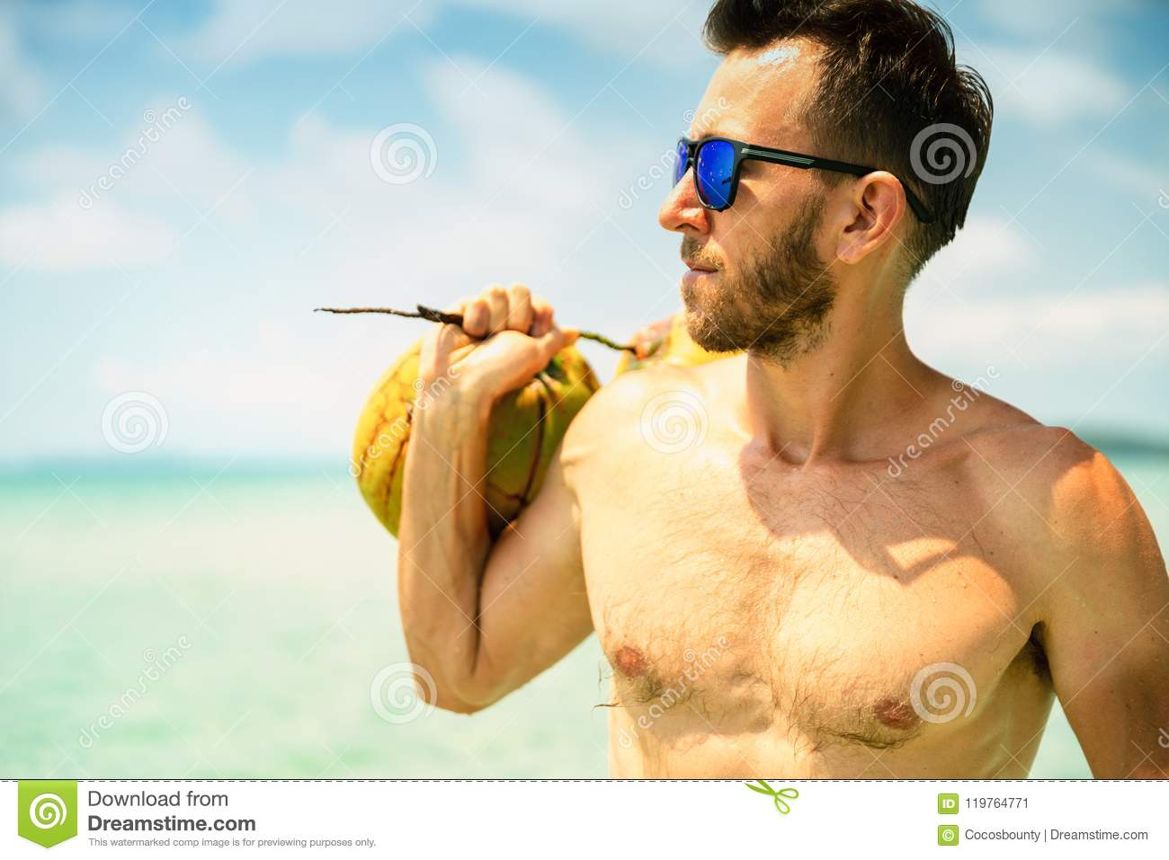 8aa67385eb23 Muscular young athletic man lying on the beach with a naked torso in  underwear. Young handsome man in sunglasses at the beach