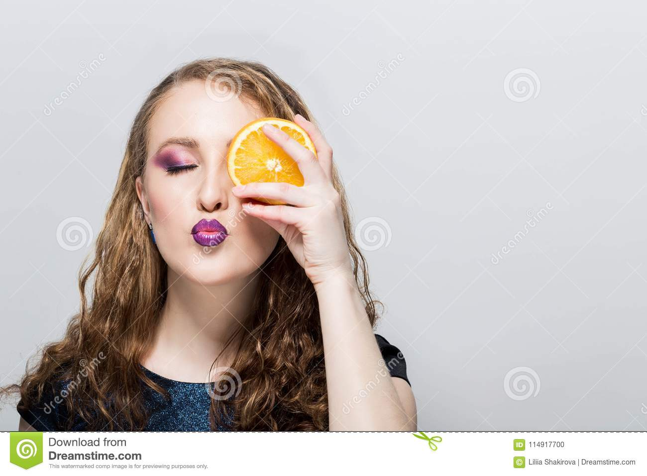 bf529e19f Portrait Of Attractive Young Woman With Oranges In Hand On White ...