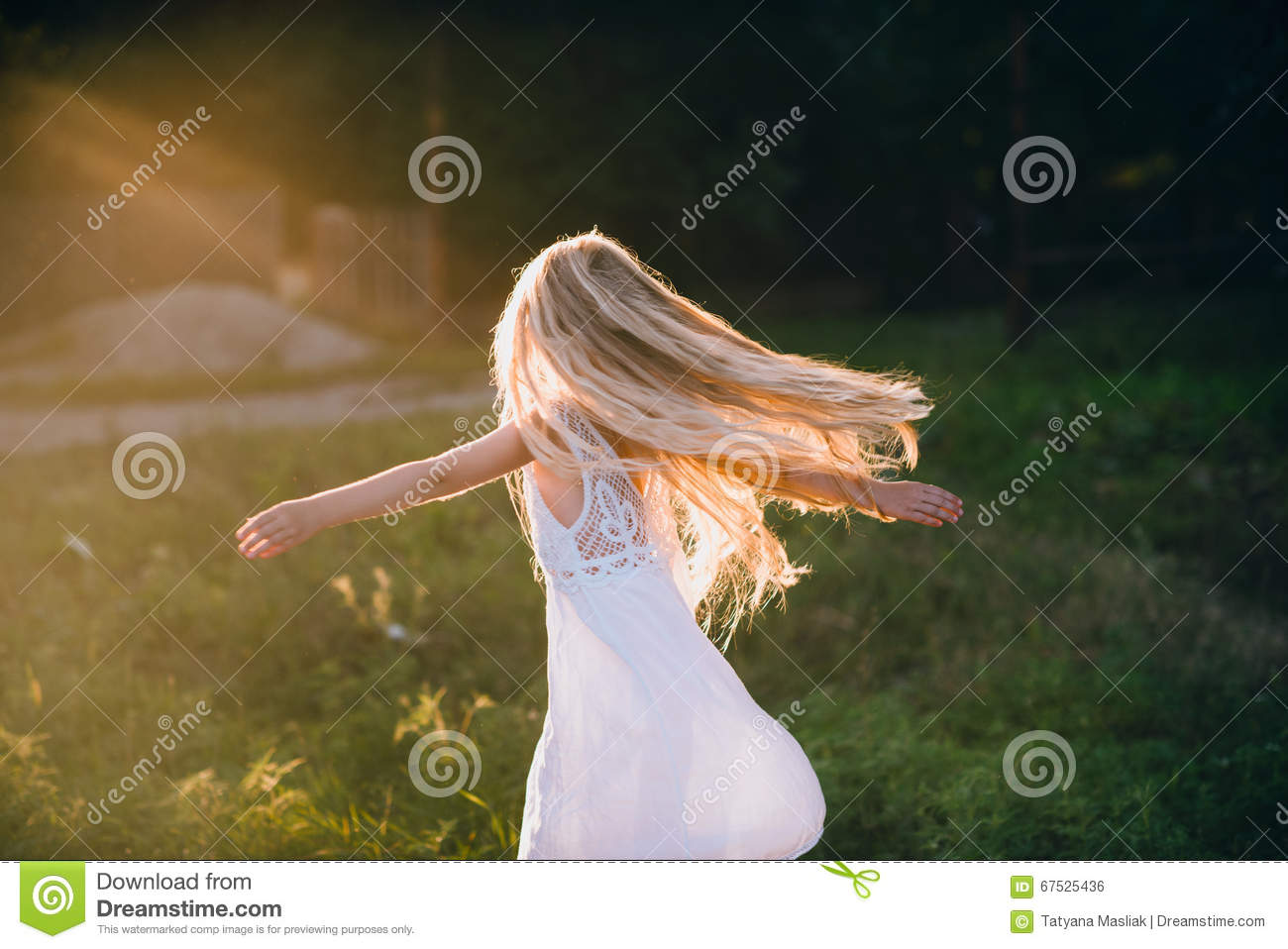 Download Portrait Of A Baby Girl Spinning In A Field In Sunset Light Stock Photo - Image of grass, hair: 67525436