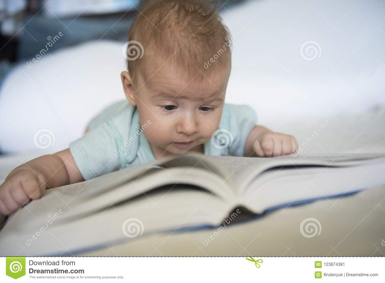 Portrait Of Baby Girl Trying To Read Book Stock Image