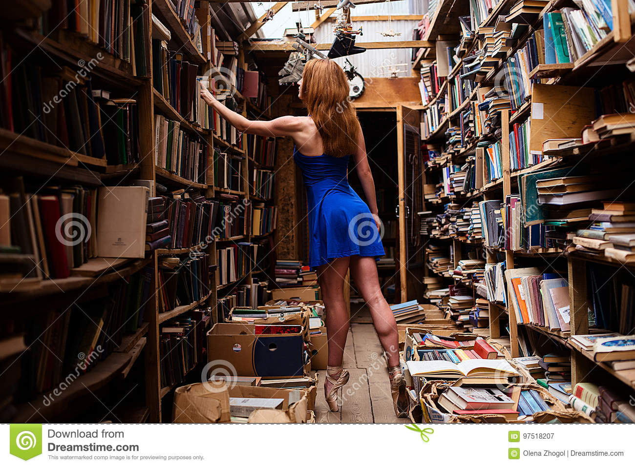 Portrait of ballerina girl in vintage book store wearing casual clothes