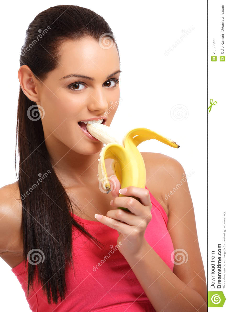 black woman eating banana portrait of a banana eating young woman in studio stock 5941