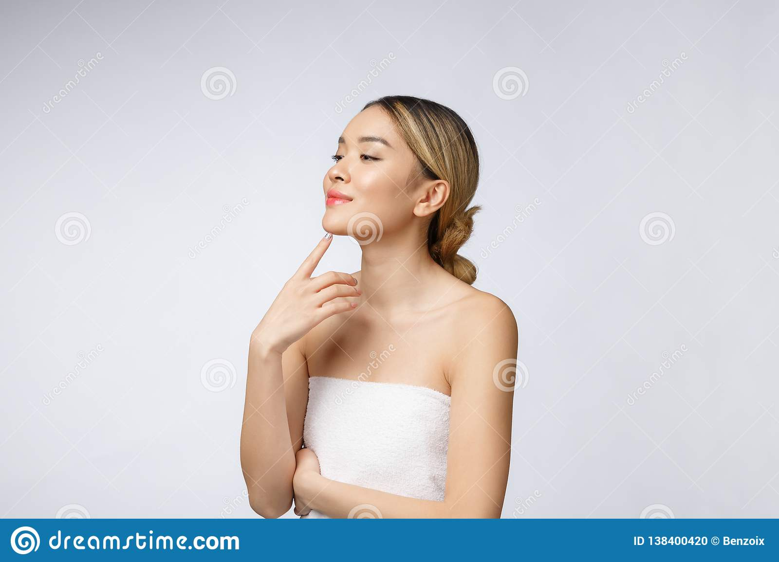 Portrait of beautiful asian woman makeup of cosmetic, girl hand touch cheek,face of beauty perfect with wellness