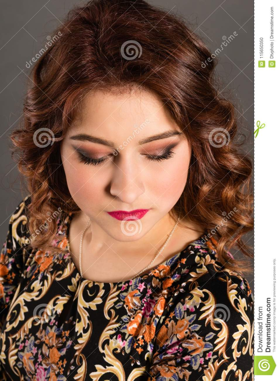 Portrait of an attractive girl with lowered eyes