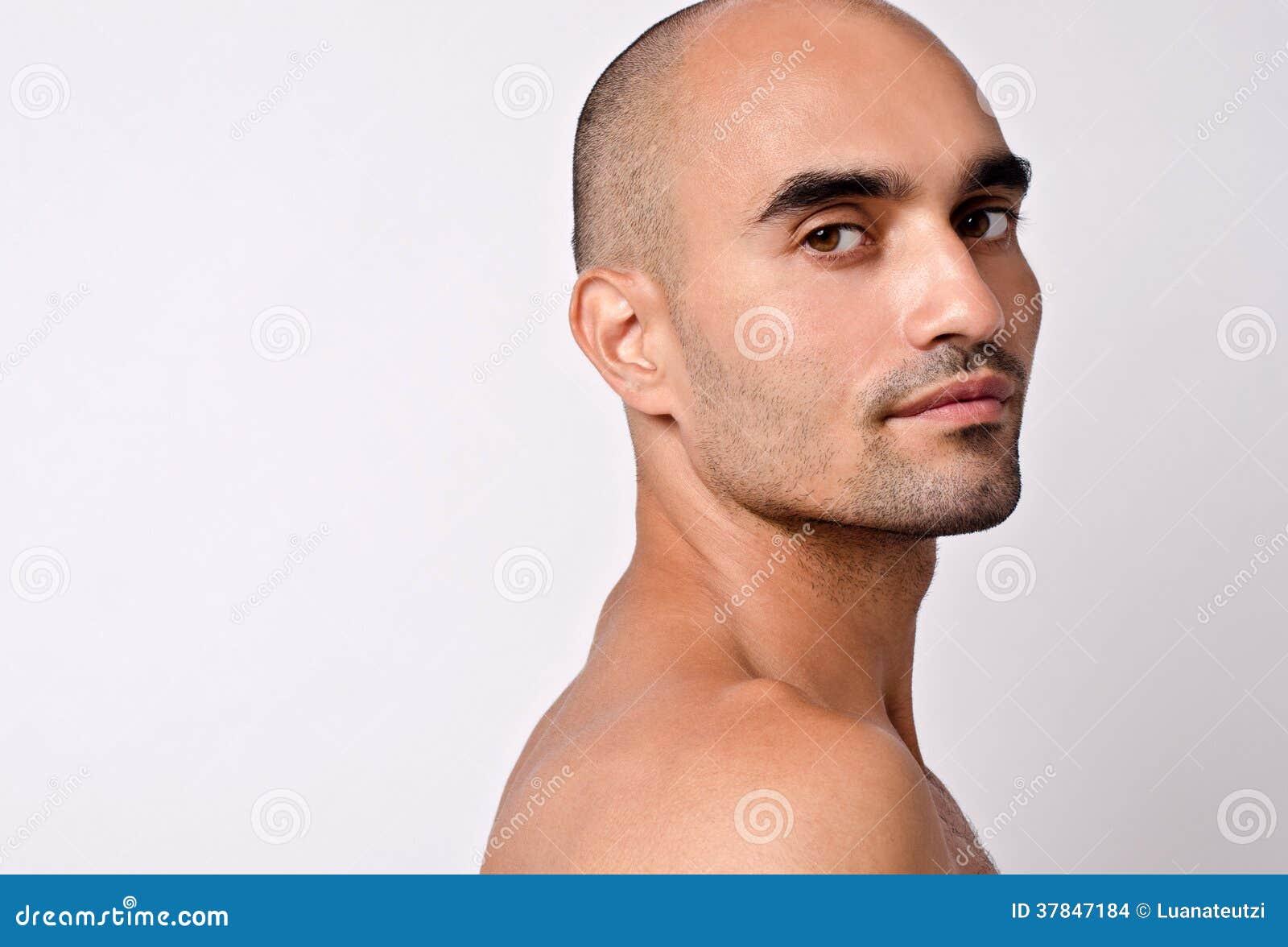 portrait of a beautiful bald man looking over his shoulder. Black Bedroom Furniture Sets. Home Design Ideas