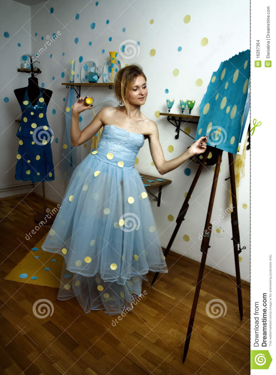 Portrait of a beautiful blond lady painting dots