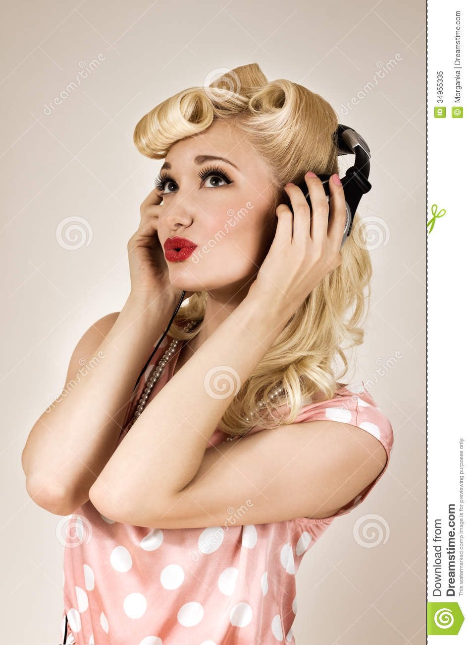 Portrait Of Beautiful Blonde Girl Listening To Music