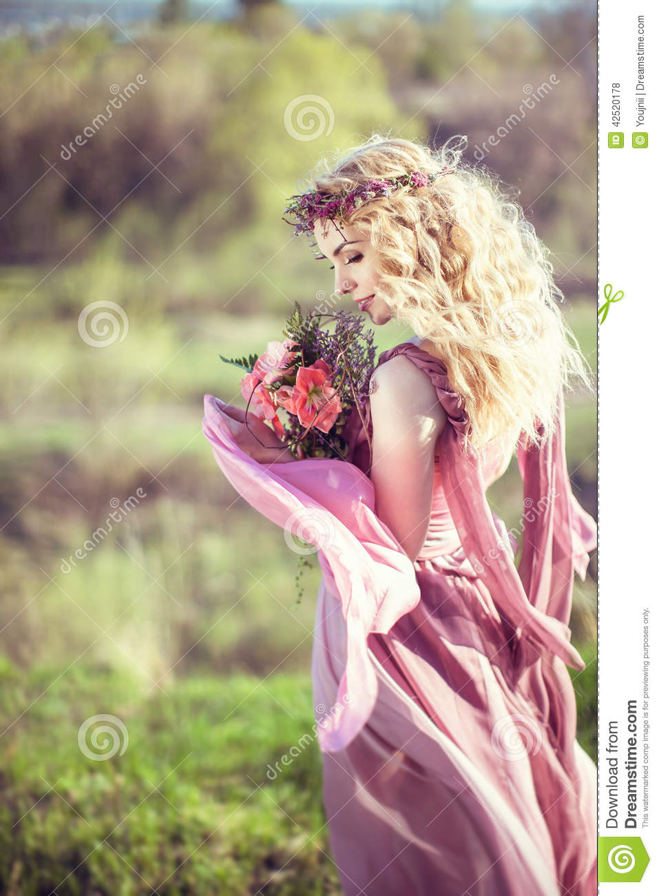Portrait of a beautiful blonde girl in a pink dress